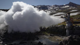 Natural mineral thermal steam-water emission from well, geothermal deposit area Footage