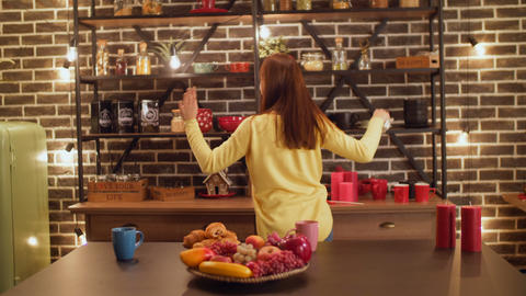 Joyful woman dancing doing housework in kitchen Footage