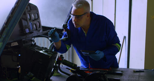 Engineer examining aircraft using digital tablet 4k Live Action