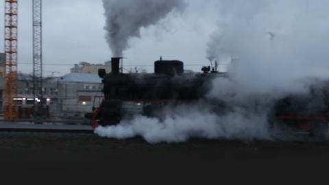 train in clouds of smoke and steam passes by Live Action