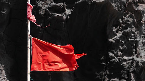 Close-up of broken red flag moved by the wind. Slow motion ビデオ