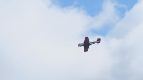 Light sports aircraft performs aerobatics in the sky Live Action