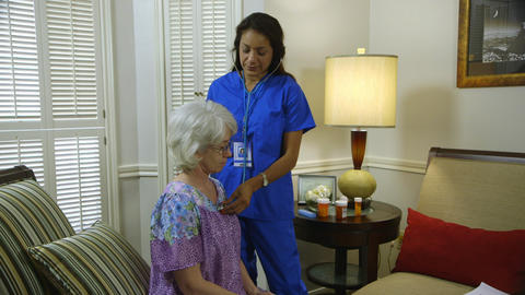 home healthcare nurse checking her patients breathing Footage