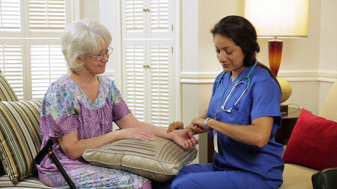 home healthcare nurse taking pulse of her patient Footage