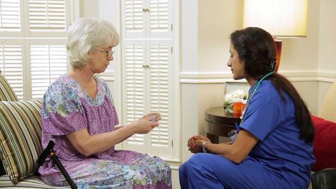 patient asking the home healthcare nurse questions about pills Live Action