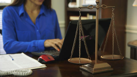 woman attorney working focus on scales of justice Footage