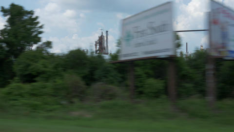 driving view of a large oil refinery Footage