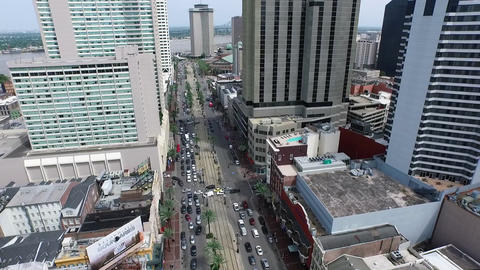 aerial pan past Mississippi River over famous Canal Street to cityscape Footage
