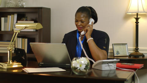 businesswoman corporate CEO working at her desk answers phone Footage