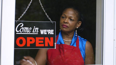 woman small business owner opening her shop Footage