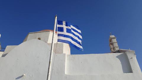 Mykonos, Greece - Greek flag before a church Footage
