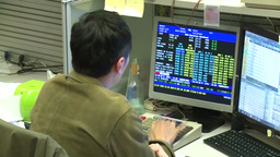 Stock trader investing in shares in Hong Kong Stock Market HKE Footage