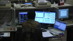 TRADER WORKING INVESTING HONG KONG STOCK EXCHANGE ON A COMPUTER Footage
