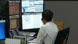 KOREA EXCHANGE BANK TRADER STOCKBROKER DEALING STOCKS ON COMPUTER Footage