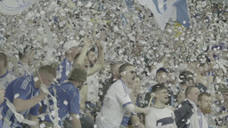 Spectacular support of football fans for their team . Slow motion Footage