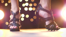 Shooting of black high black heels on legs of woman walking with outbreaks from Footage