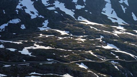 White van on winding mountain road in Norway Footage
