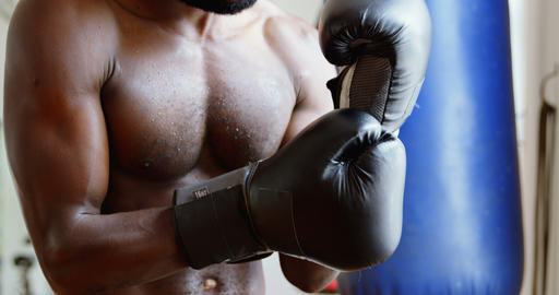 Male boxer in aggressive mood in fitness studio 4k Live Action