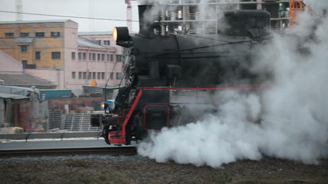 steam train in clouds of smoke passes by Live Action