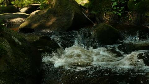 Mountain stream among huge boulders Footage