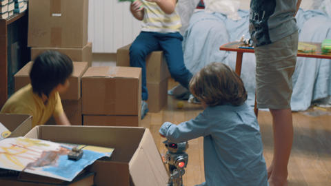 Group of kids playing among boxes Footage