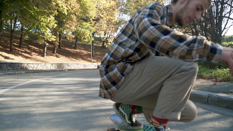 Skateboarder rides lying on a skateboard outdoors.... Stock Video Footage