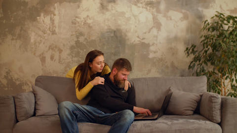 Man busy working laptop while girl feeling lonely GIF