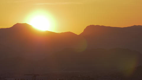 A bright orange sunset in the mountains Footage