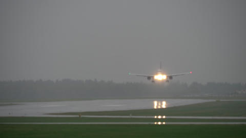 Plane landing during a storm Live Action