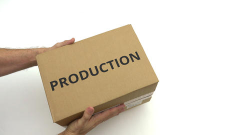 Man gives box with PRODUCTION text on it Live Action