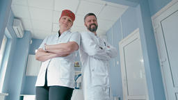 Portrait of Two Confident Doctors with Arms Folded Standing in the Hospital Room Footage