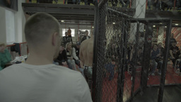 Male fighter comes into the cage before the fight . MMA. Octagon Footage