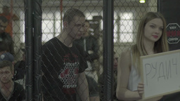 Fighter walks into the cage before the fight . Octagon. MMA. Slow motion Footage