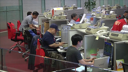 TRADERS AND STOCKBROKERS INVESTING AND TRADING STOCKS AT HONG KONG STOCK EXCHANG Footage