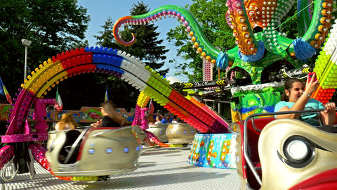 Children And Parents Having Fun In Youths Public Amusement Park Ride Footage