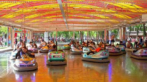 Children And Parents Having Fun On Bumper Cars Ride Footage