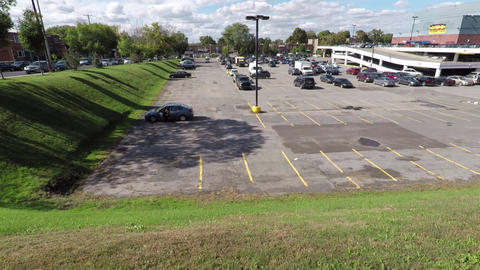 Parking lot surrounded by green grassy hills Footage