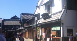People coming and going on the old fashioned street at Kawagoe wide shot Footage