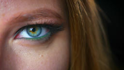 Amazing green and blue eyeshadows close up on caucasian girls eye close up Footage