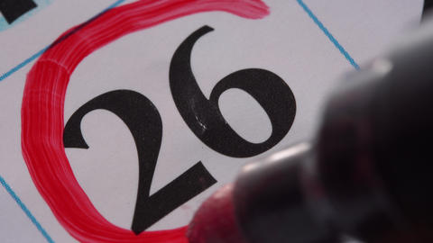 Marking the date in the calendar with a red marker Footage
