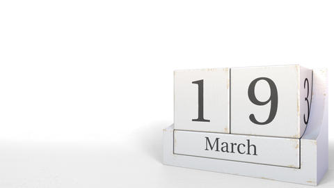 March 19 date on wooden blocks calendar. 3D animation Footage