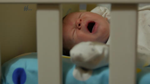 Newborn Baby Yawning In Bed GIF