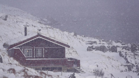 House on the Shore of the Fjord and Snowfall. Slow Motion Archivo