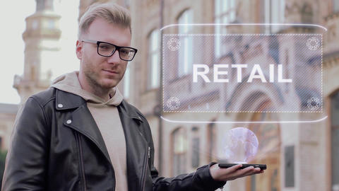 Smart young man with glasses shows a conceptual hologram Retail Footage