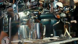 Barista is Making Coffee with Professional Metal Coffee Machine in a Cozy Cafe Archivo