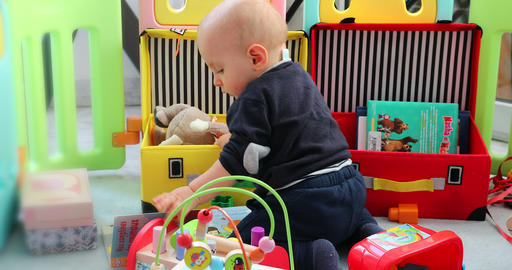 Baby Boy Playing With His Toys In Playpen Footage