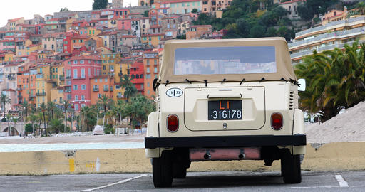 Vintage Volkswagen Thing Car With The Old Town Of Menton In The Background GIF