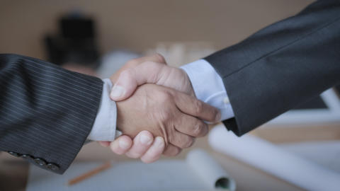 Manager Shaking Hands With Colleague After Business Meeting For Contract Live Action