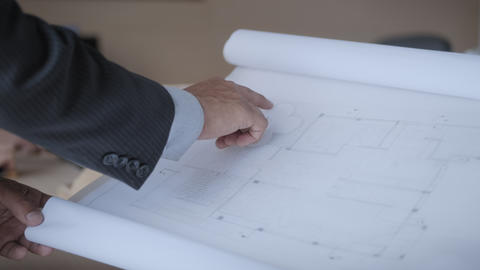 Architect Reviewing Building Blueprints As Project Manager In Office Footage