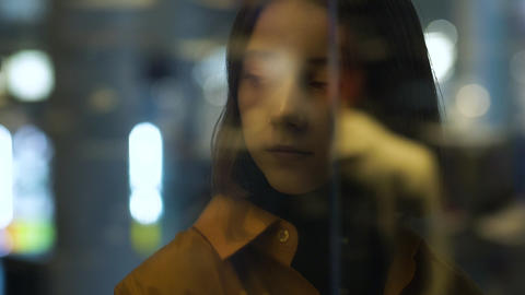 a young female model through the window reflection Footage